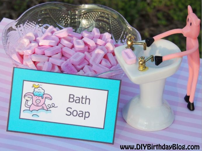 Piggy Bubble Bath Birthday Party- Free Birthday Party Printables- DIY Birthday Blog- Piggy Bath Soap Pez Candies With Piggy At The Sink